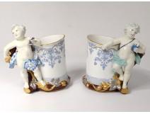 Pair porcelain mugs cherubs putti amours vine nineteenth century