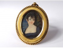 Small painted miniature oval portrait young woman bronze frame nineteenth century