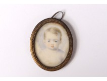 Small painted miniature oval pendant portrait young child nineteenth century