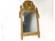 Large Revolutionary mirror in carved gilded wood helmet oak leaves eighteenth