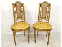 Pair of Louis XVI caned chairs carved gilded wood arrows knots late nineteenth