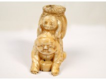 Netsuke carved ivory figure with wicker basket and Asian frog, Japan, nineteenth