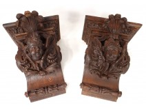 Pair consoles of wooden carved wood heads antifreezes putti foliage XIX
